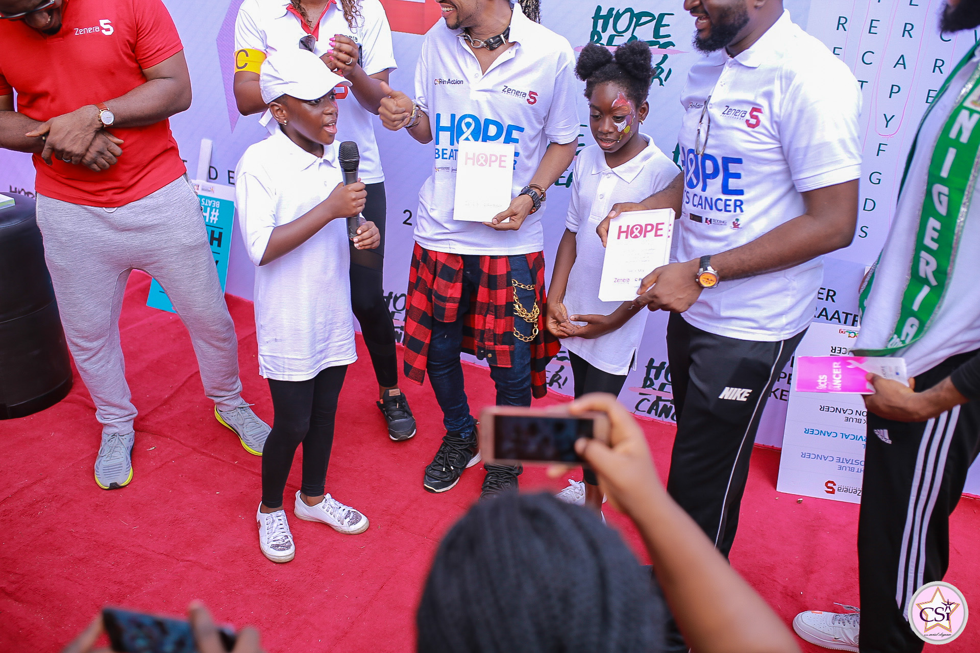 Aramide, Denrele, Tee-y mix, others join Zenera consulting's cancer awareness walk